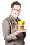 Popcorn Bucket On Businessman's Hand