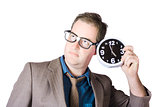 Businessman Holding Clock Near Ear