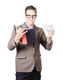 Businessman With Book And Crumpled Paper