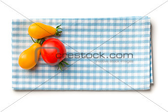 tomatoes on checkered napkin