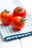 red tomatoes on napkin