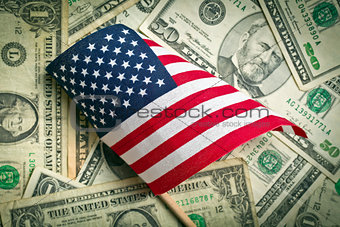 american flag with us dollars