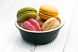 colorful macaroons in bowl