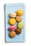 colorful macaroons on checkered napkin