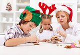 Kids decorating gingerbread cookies