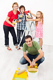 Family repainting their home together