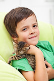 Young boy with his kitten