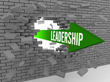 Arrow with word Leadership breaking brick wall.