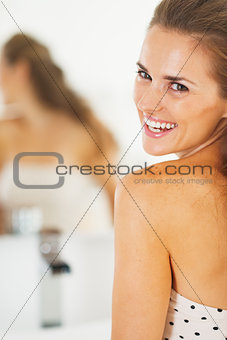 Portrait of happy young woman in bathroom