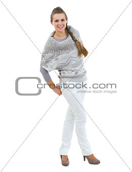 Full length portrait of happy young woman in sweater