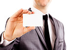 Young business man holding a blank business card