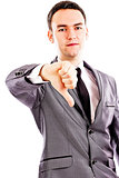 Disappointed young business man showing thumb down sign
