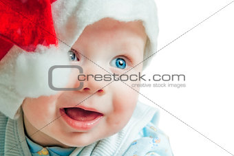 Portrait of a baby in a Christmas hat Sata Claus