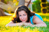 Brunette girl lying on the grass