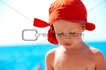 Thoughtful child on sea background