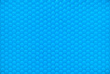 Blue shiny hexagon bubble tile texture background