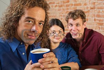 Grinning Man with Coffee Mug