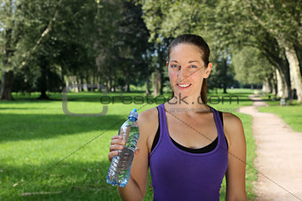 Athletic young woman with a water bottle