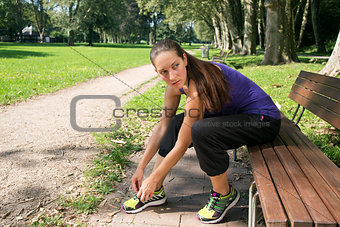 Attractive woman takes a break after sports