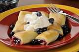 Blueberry blintzes with shipped cream