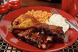 Barbecued ribs and chicken