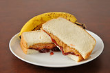 Peanut butter and jelly sandwich with a banana