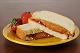 Peanut butter and strawberry jam sandwich
