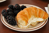 Croissant with cream cheese and blackberries