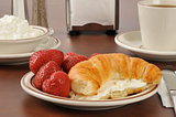 Croissant with strawberries and cream cheese