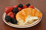 Croissant with strawberries and blackberries