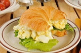 Egg salad sandwich on a croissant