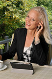 Mature attractive businesswoman working outdoors