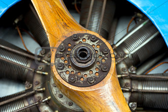 Old aircraft engine with wood propeller, vintage plane close up