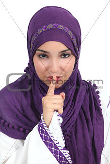 Beautiful arab woman asking for silence with the finger on lips