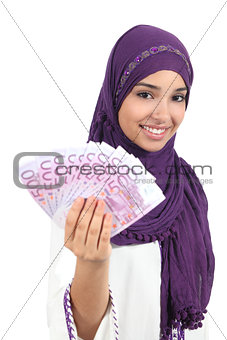 Beautiful arab woman holding and showing money