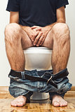 Man sitting on toilet
