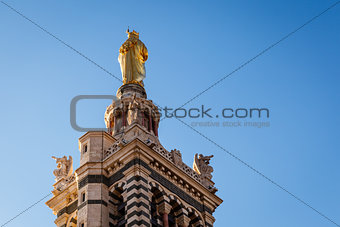 Golden Statue of the Madonna Holding the little Jesus on the top