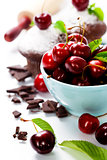 fresh chocolate muffins with cherry