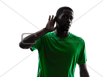 african man soccer player  silhouette hearing gesture
