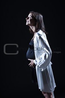 beautiful caucasian pregnant  woman in nightie