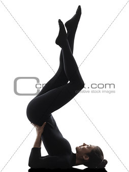 woman exercising gymnastic salamba sarvangasana Shoulder Stand y