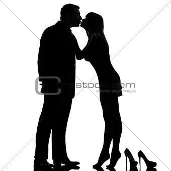 one couple kissing man and woman barefoot tiptoe