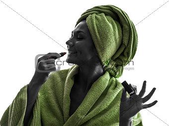woman applying lipstick silhouette