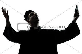 man priest praying silhouette