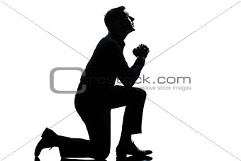 silhouette man kneeling praying  full length