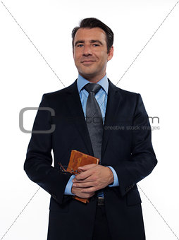 Man teacher holding book smiling