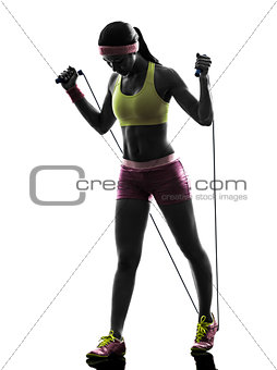 woman exercising fitness jumping rope  silhouette
