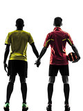two men soccer player  standing hand in hand silhouette