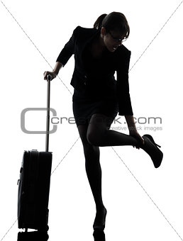 business woman traveling massaging feet silhouette