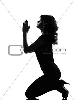 silhouette woman kneel praying imploring